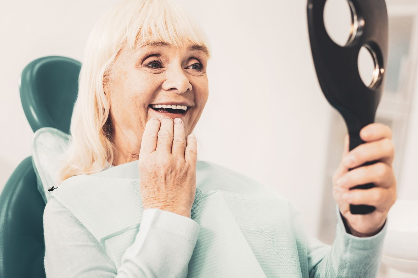Woman looks at her dentures