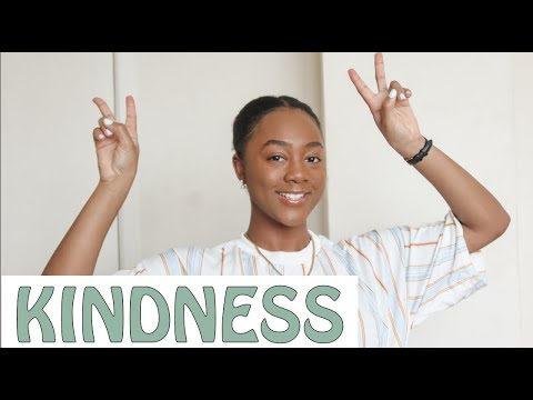 """A Youtube thumbnail of a person smiling holding up peace signs and the word """"Kindness"""""""
