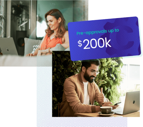 Man and woman on laptop smiling upon the realization they received pre approvals of up to two hundred thousand dollars