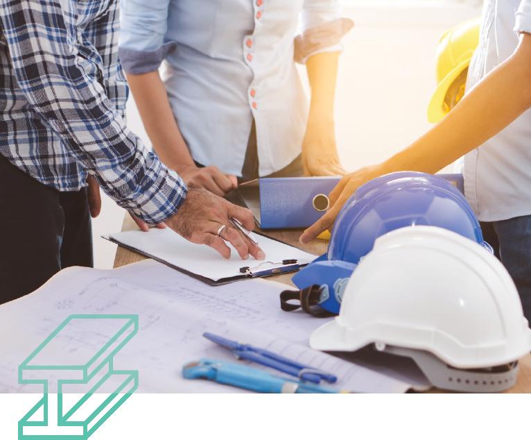 Builders looking at blueprints