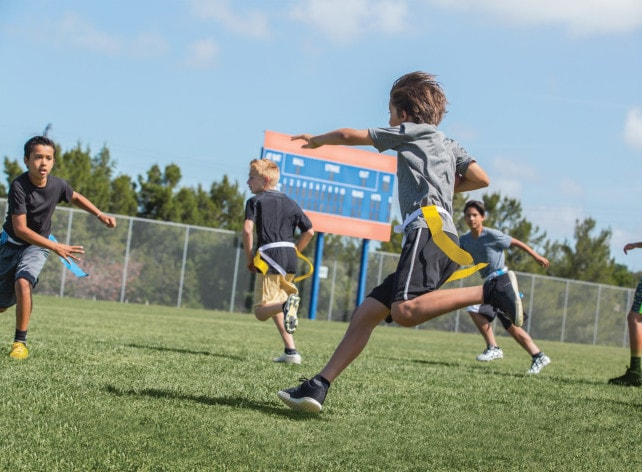 Boys playing flag soccer with the product produced by SKLZ customer.
