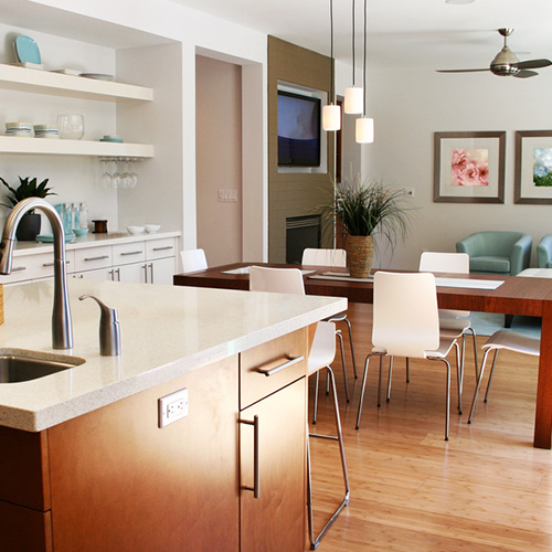An organized kitchen and living room