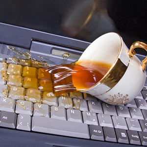 A cup of coffee spilled on a keyboard
