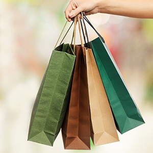 A lady holding several shopping bags