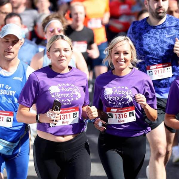2 girls running a marathon for Charity