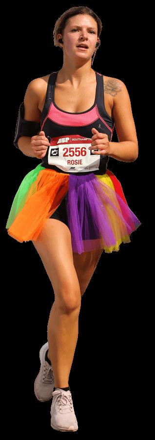 Female dressed in colourful Tutu running 10K race