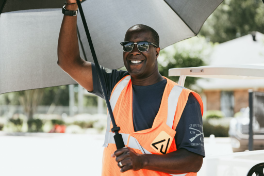 Person smiling holding a parasol