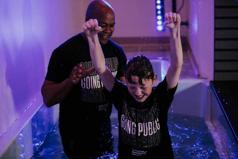 Kid getting baptized