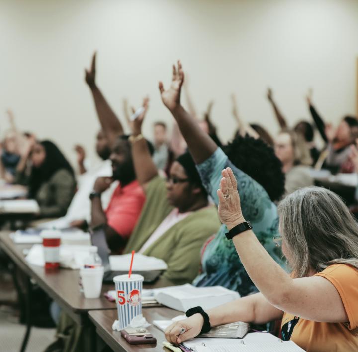 adults raising hands