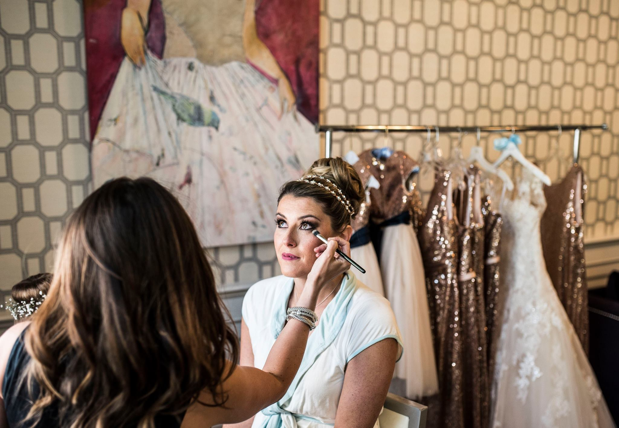 Nicolette Brycki applying makeup to a client for a wedding.