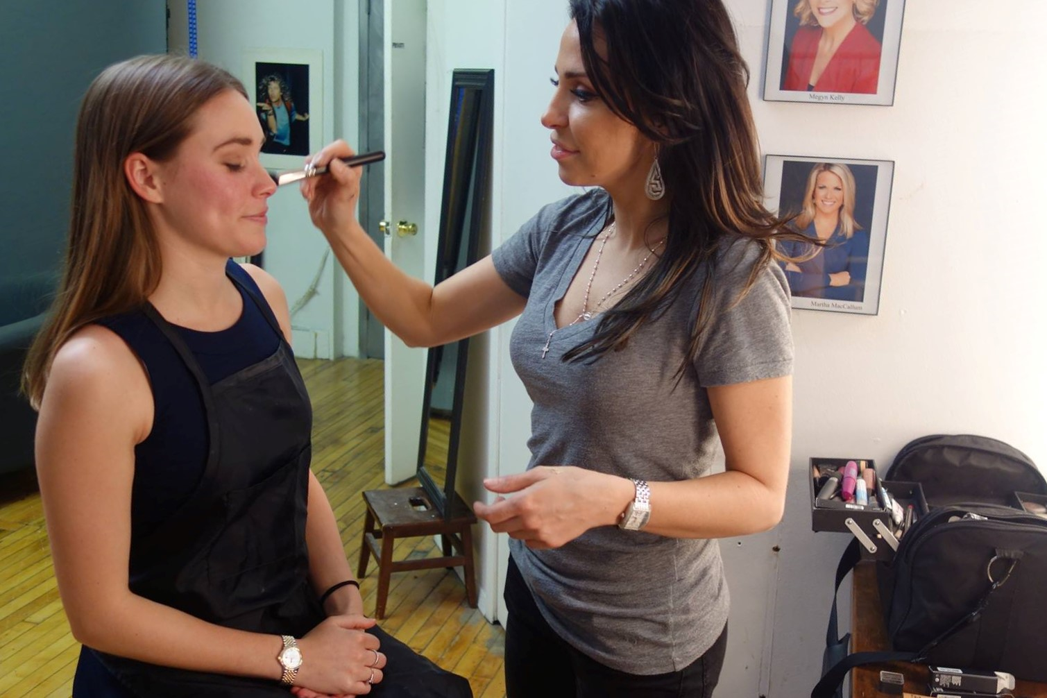 Nicolette Brycki putting makeup on a Branding & Headshot client.