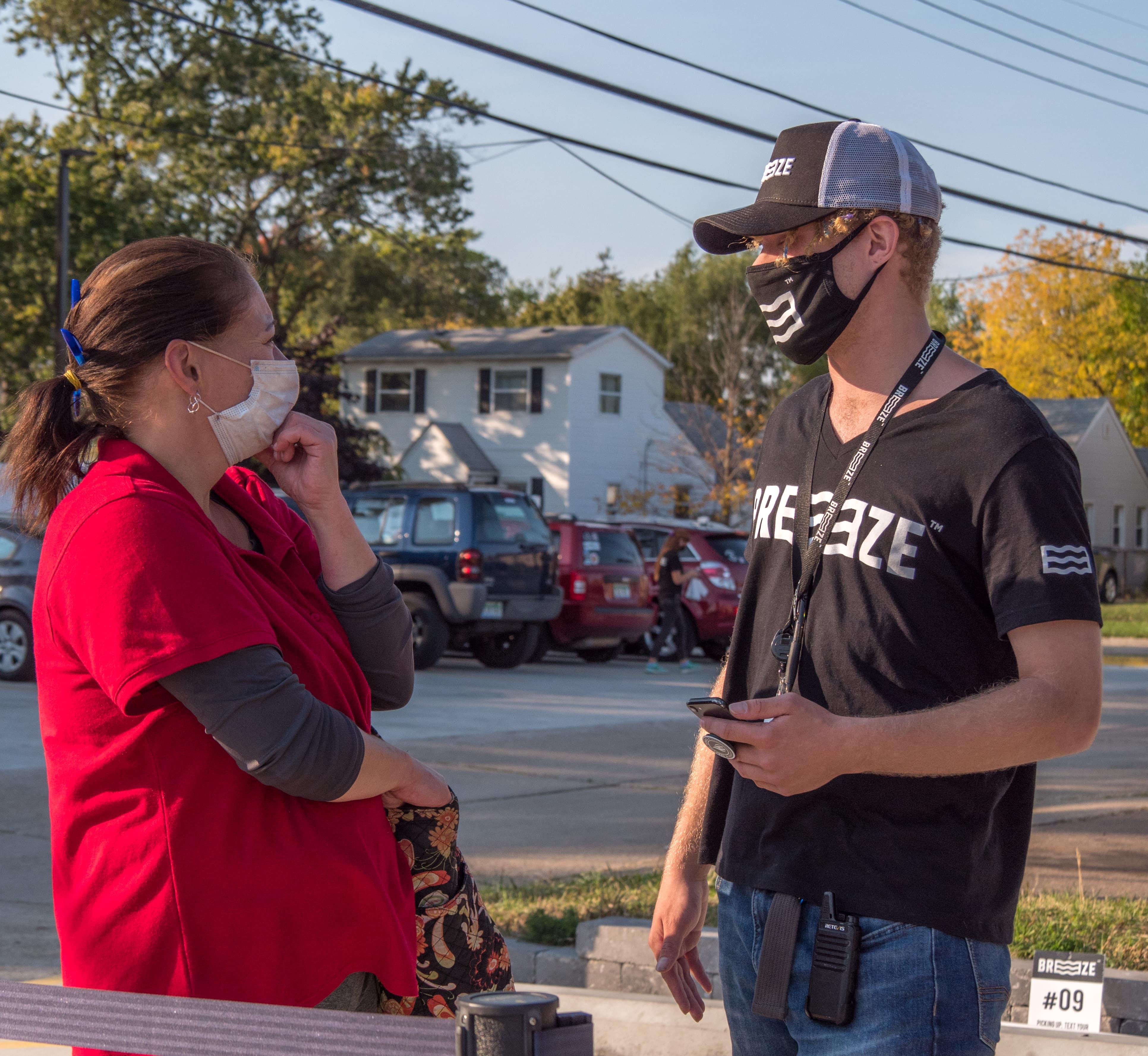 Breeze employee talking with customer