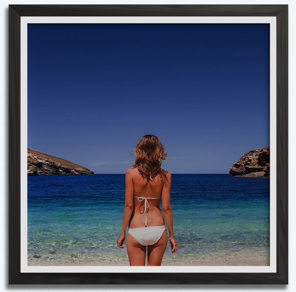 """A woman wearing a swimsuit that is looking into the sky. The Sky is where the header """"Women's Swimsuits"""" is located."""