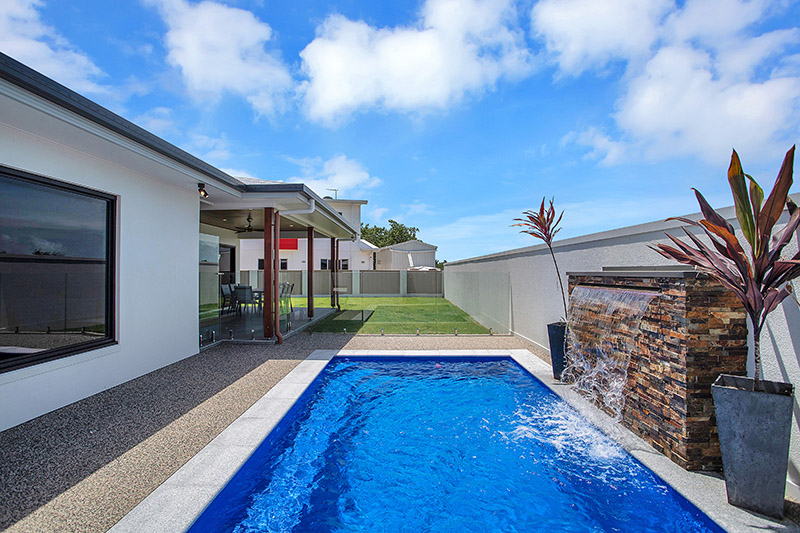 MODERN & SPACIOUS……. FOOTSTEPS TO THE BEACH