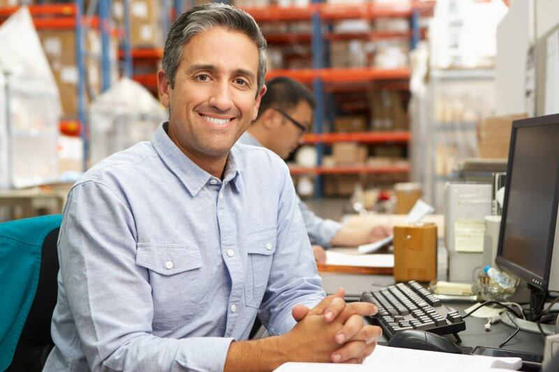 happy business owner selecting health benefits