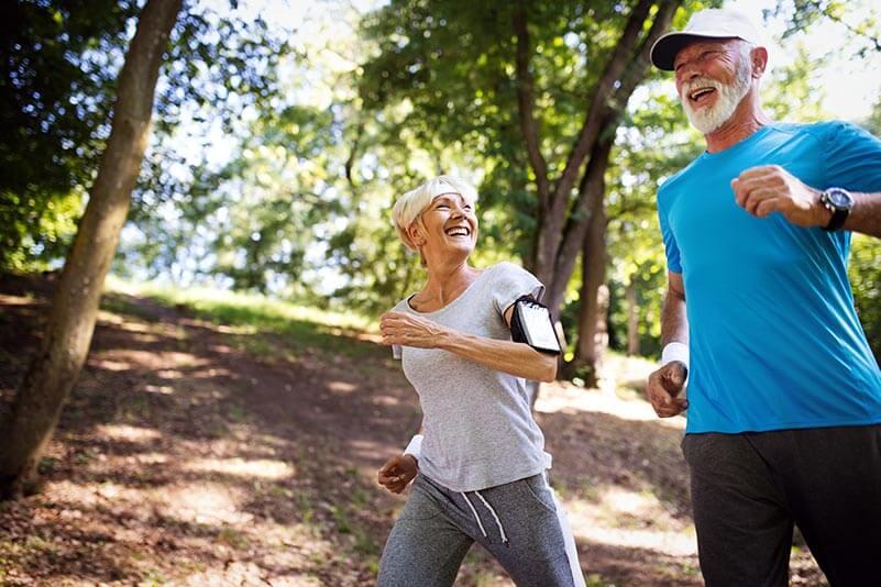 Happy senior couple running