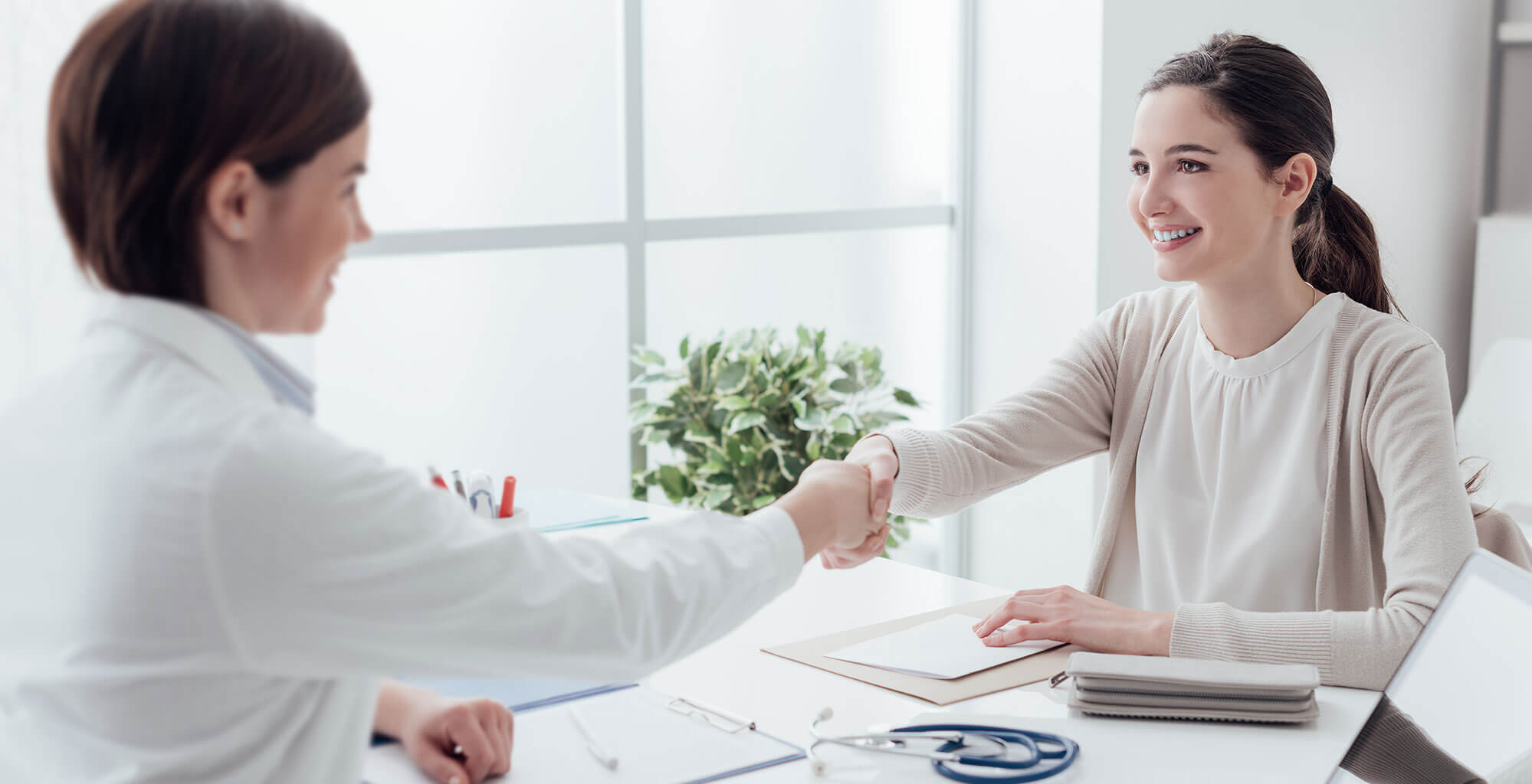 Family physician and patient shaking hands