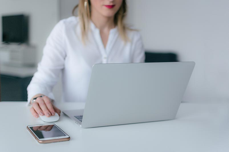 Woman browsing the internet on her laptop looking for a family doctor
