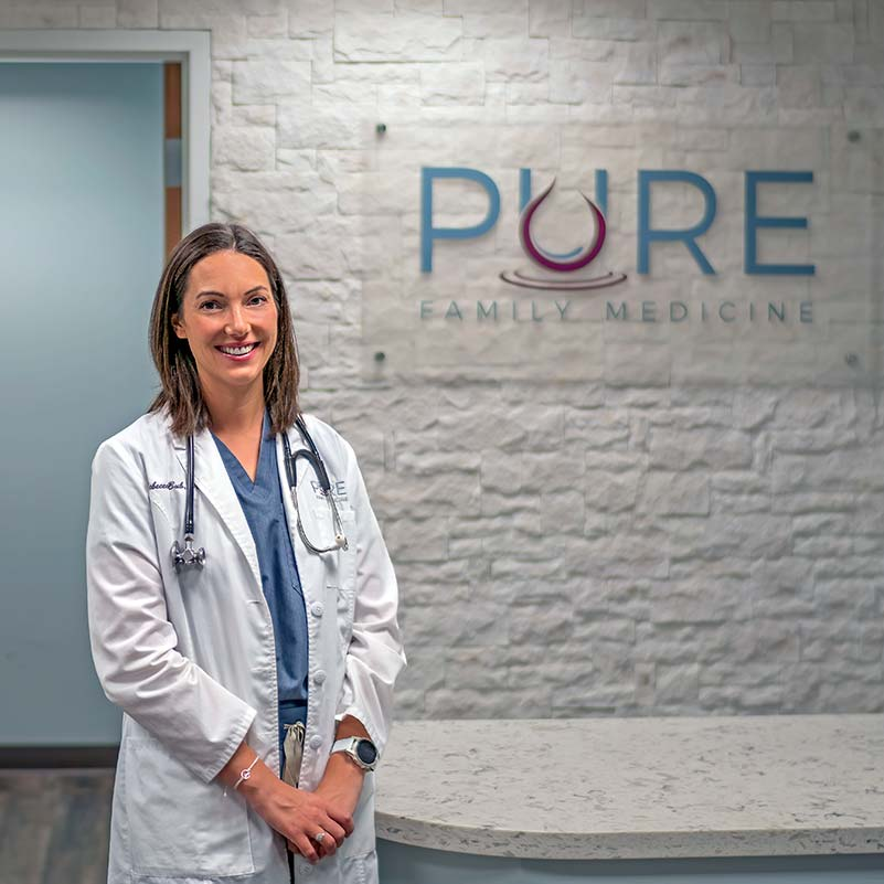 Dr. Rebecca Bub sitting at Pure Family Medicine a Direct Primary Care practice