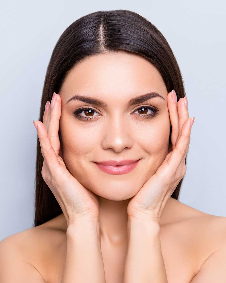Image of woman showing off skin care and facial aesthetics