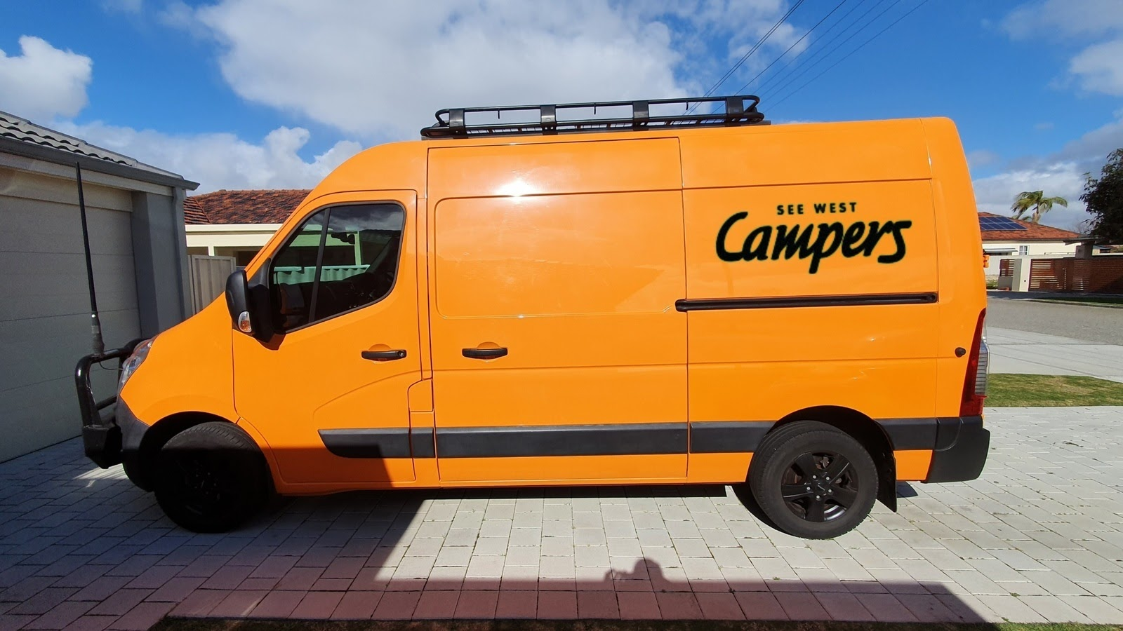 orange motorhome parked in driveway