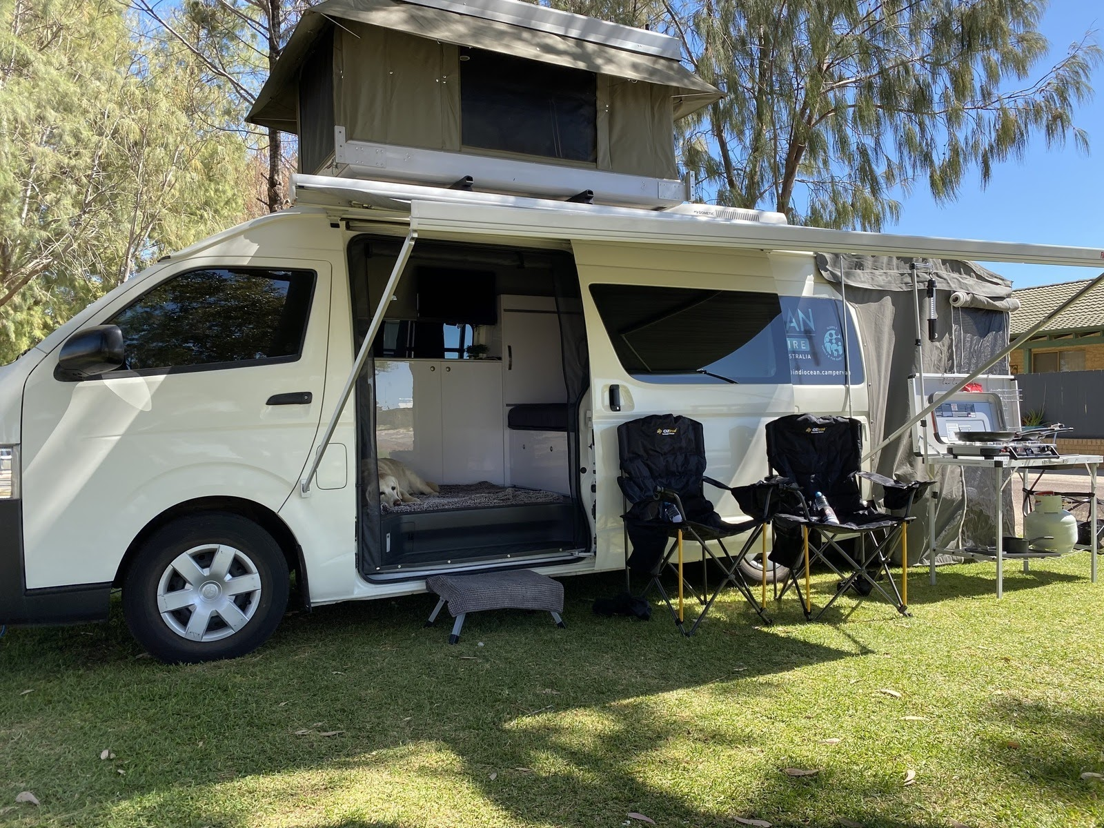 Motorhome parked on grass opened up
