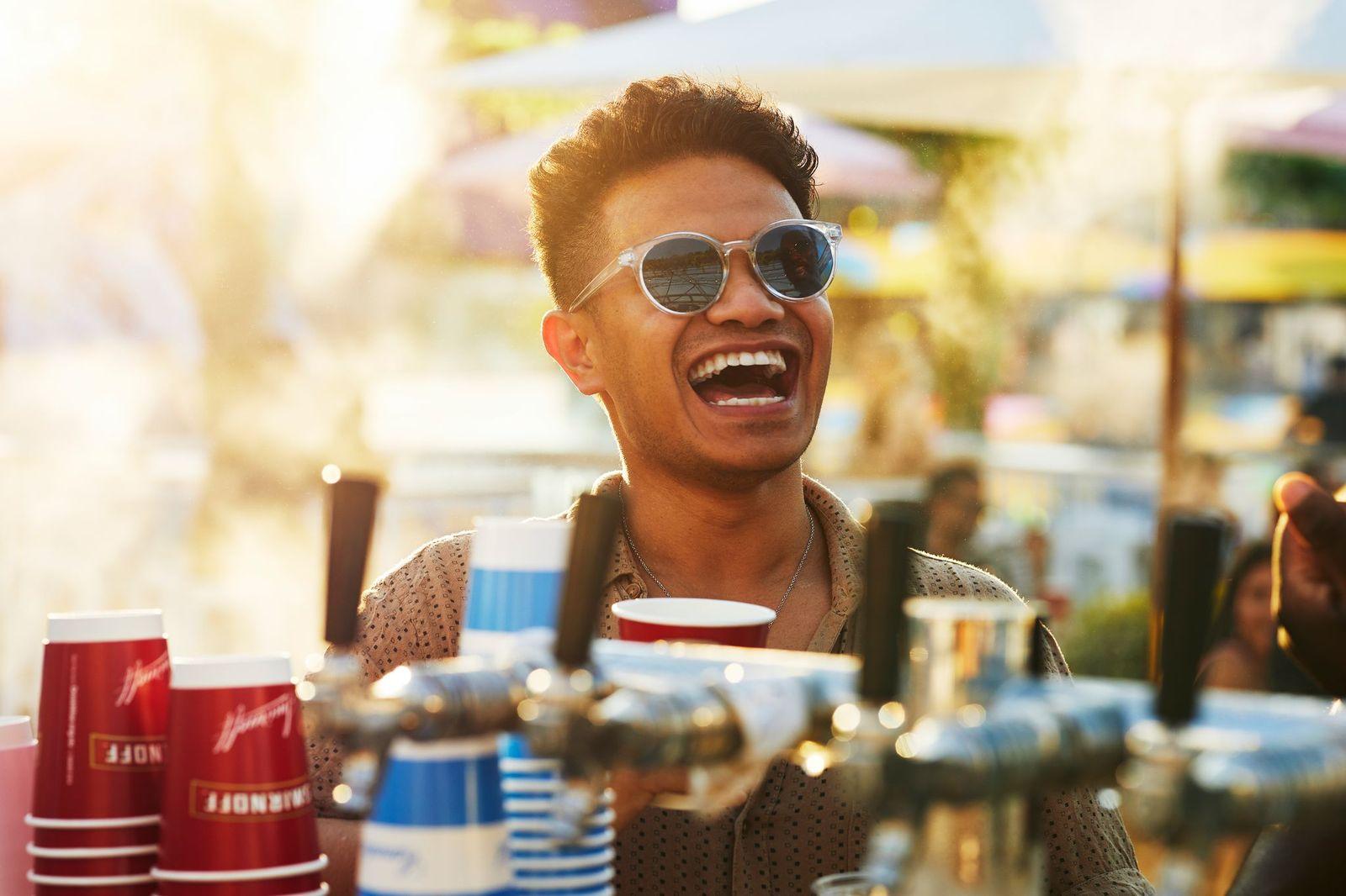 One man smiling at bar
