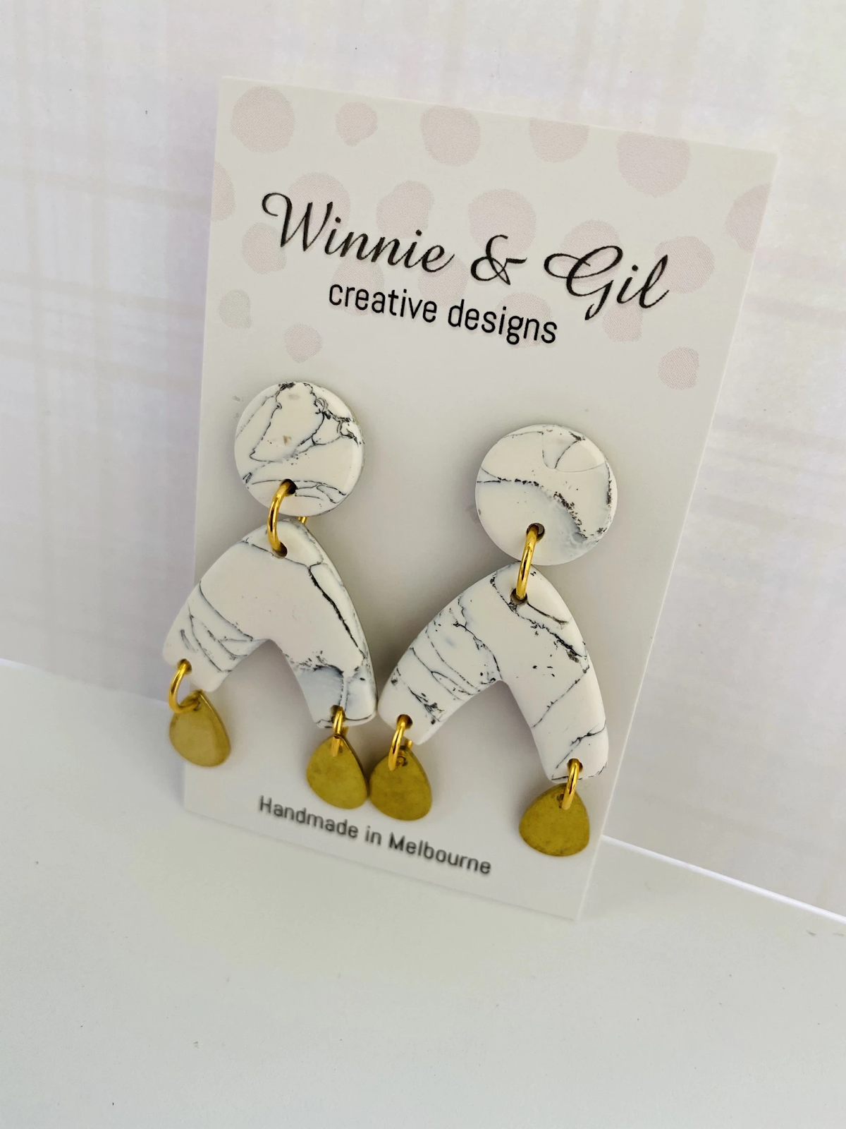 wishbone shaped faux marble earrings with gold detail