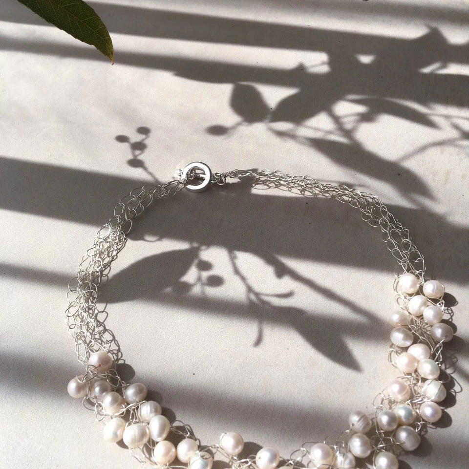 pearl necklace on wire frame