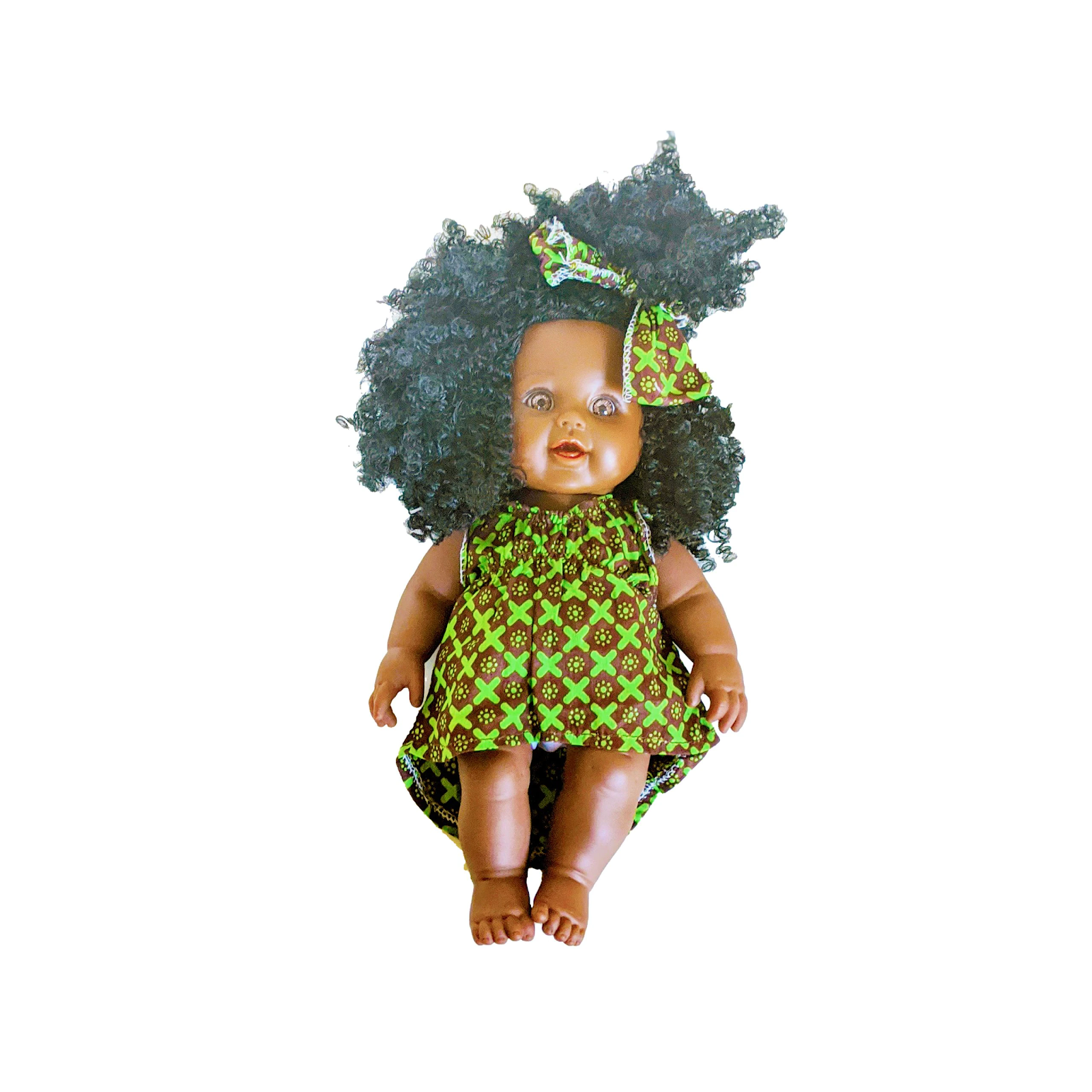 African baby doll wearing green dress