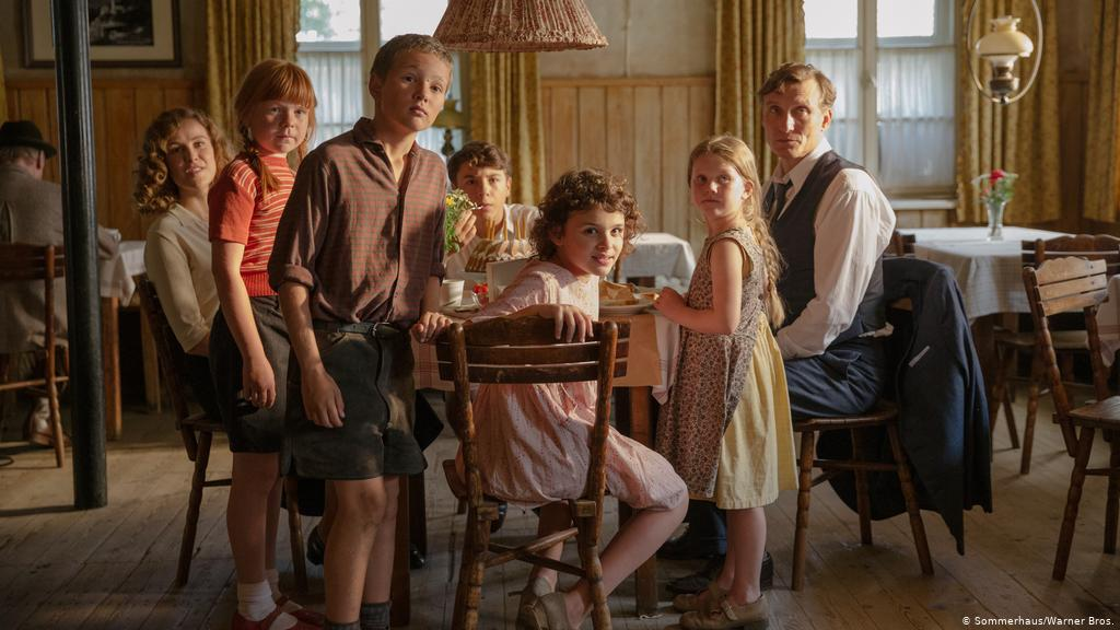 still from movie, family with five children around dinner table