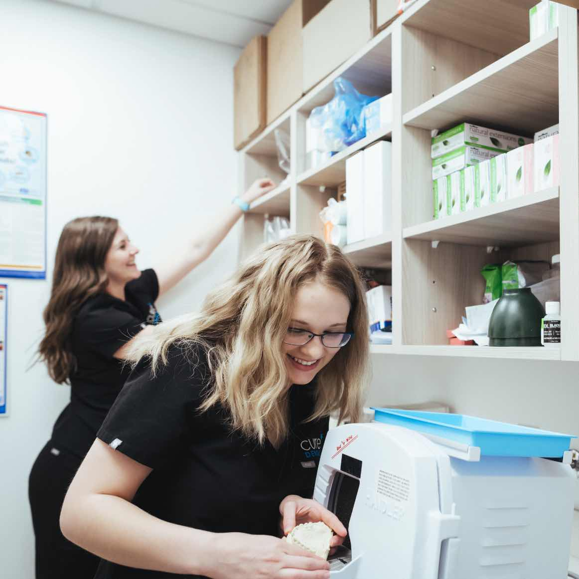 Photo of two team members working in our lab area
