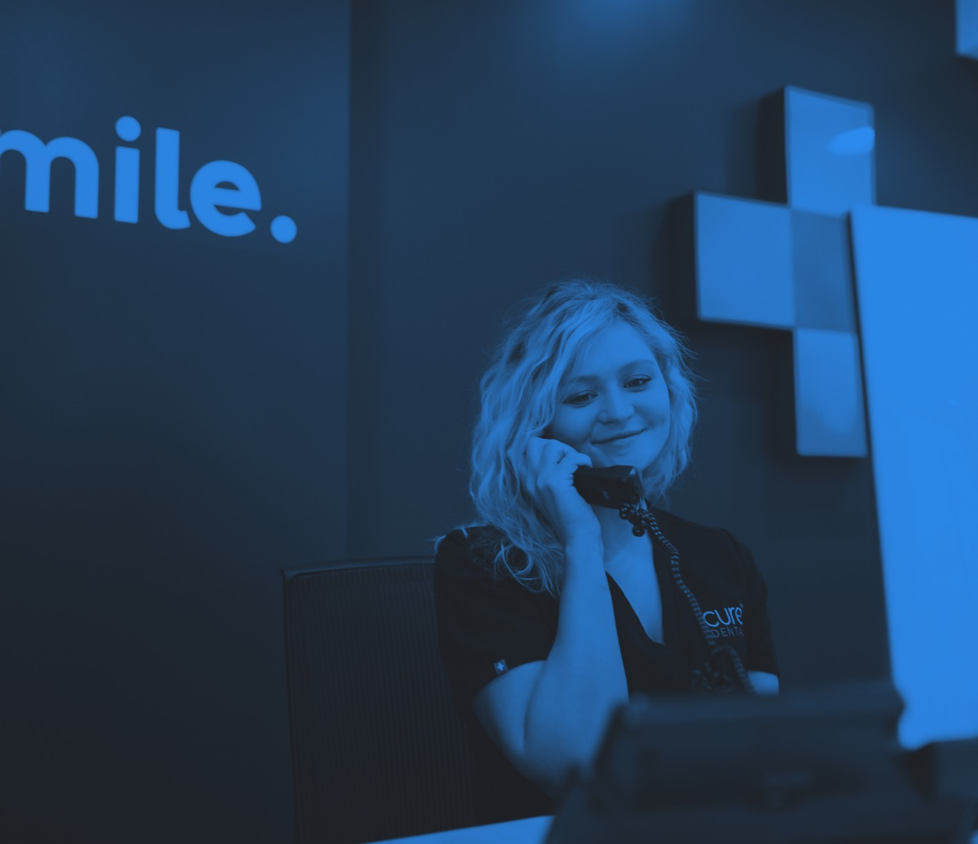Photo of a team member talking on the telephone