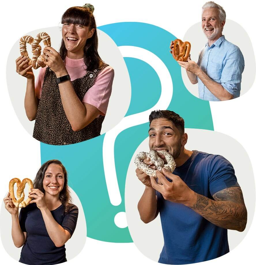 4 Pretzel Lab employees holding and eating pretzels with the Pretzel lab symbol in the background