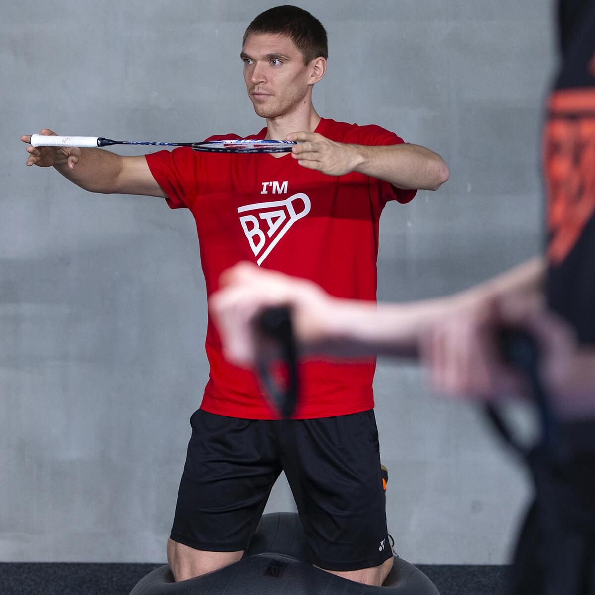 Fotografie hráče badmintonu s tričkem Czech Badminton