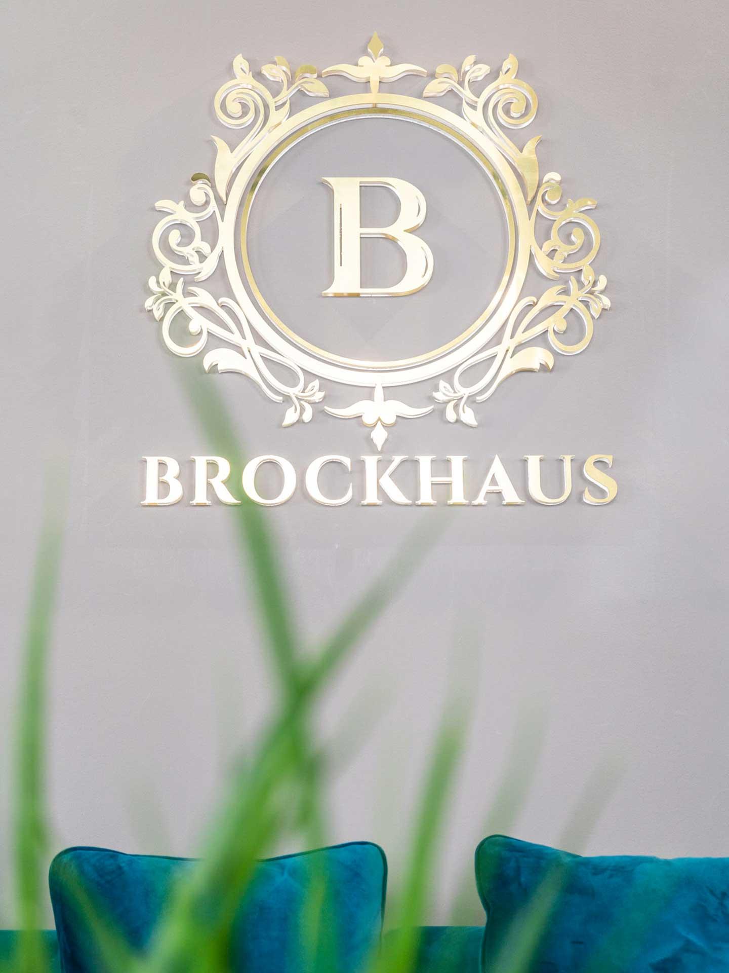 Brockhaus GmbH Immobilienmakler in Weinheim Bild Büro Logo sofa