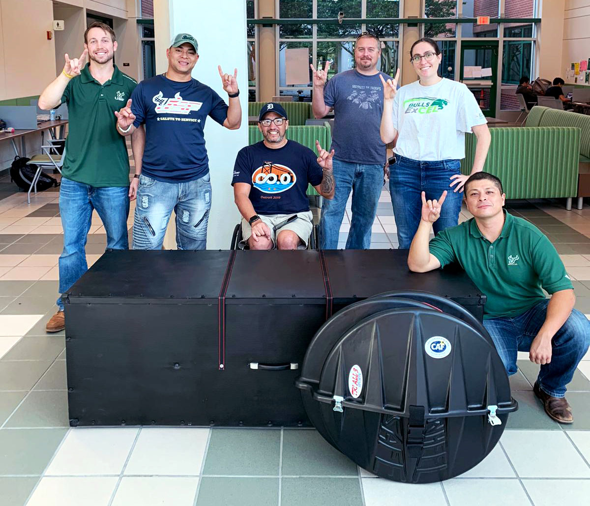 USF students with Challenger, Omar Duran and the completed Handcycle Case