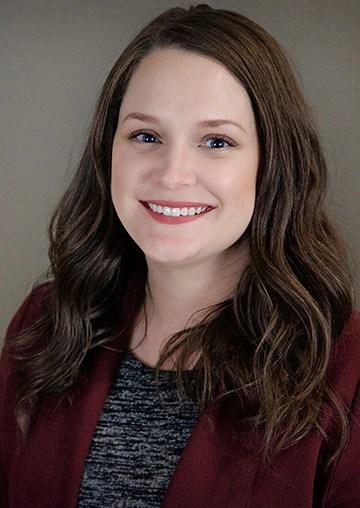 Professional portrait of Trich Caron