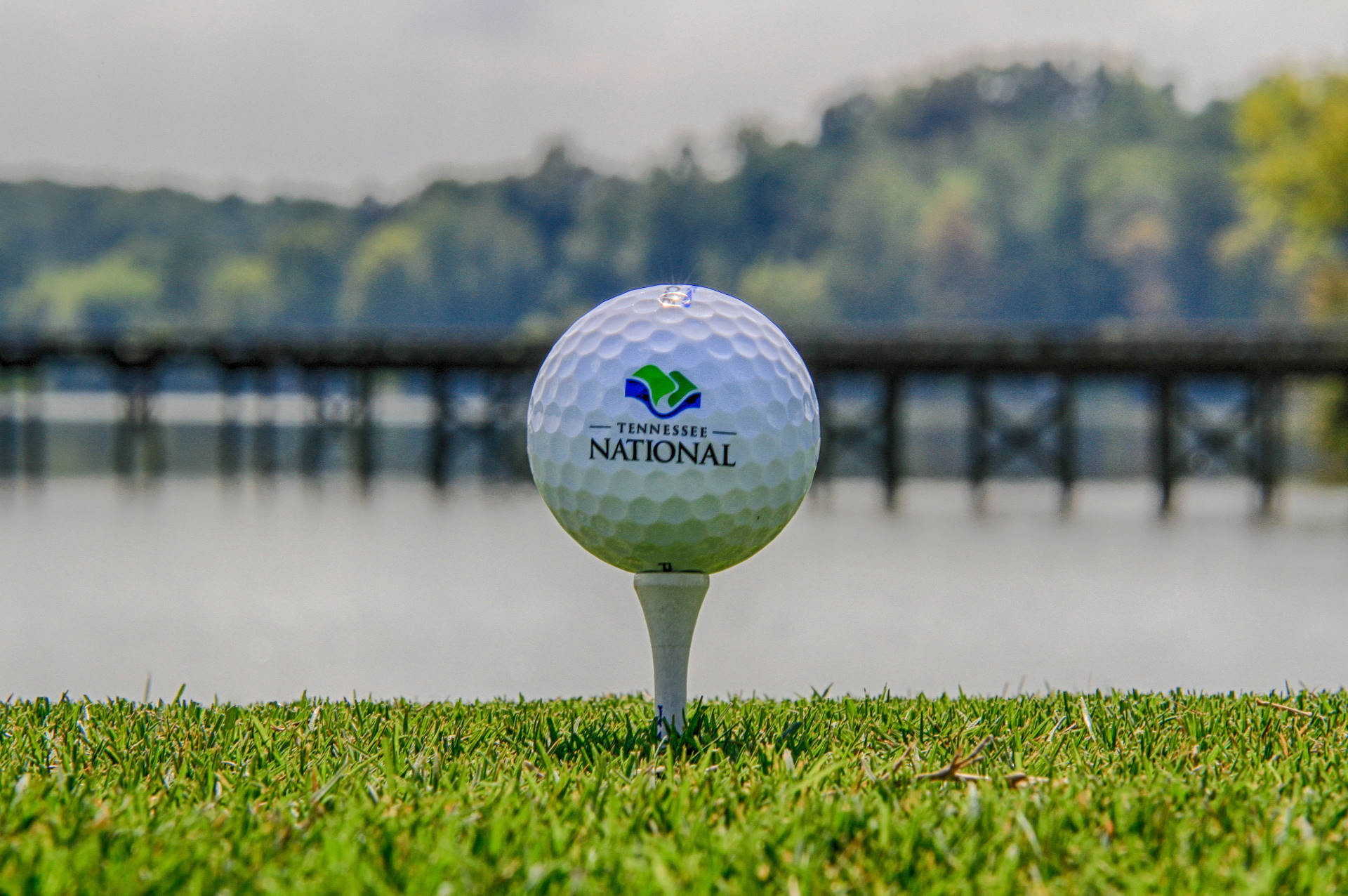 Tennessee National Logo on a Golf Ball with Lake in Background