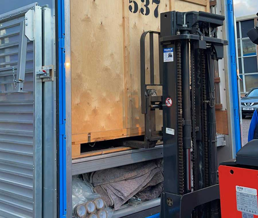 A1 Removals & Storage forklifting a container onto a truck