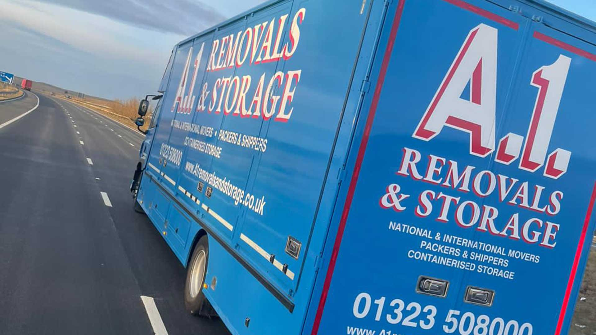 A1 Removals & Storage van driving on a motorway