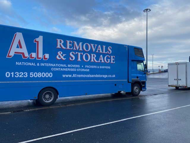 A1 Removals & Storage truck parked on the seafront
