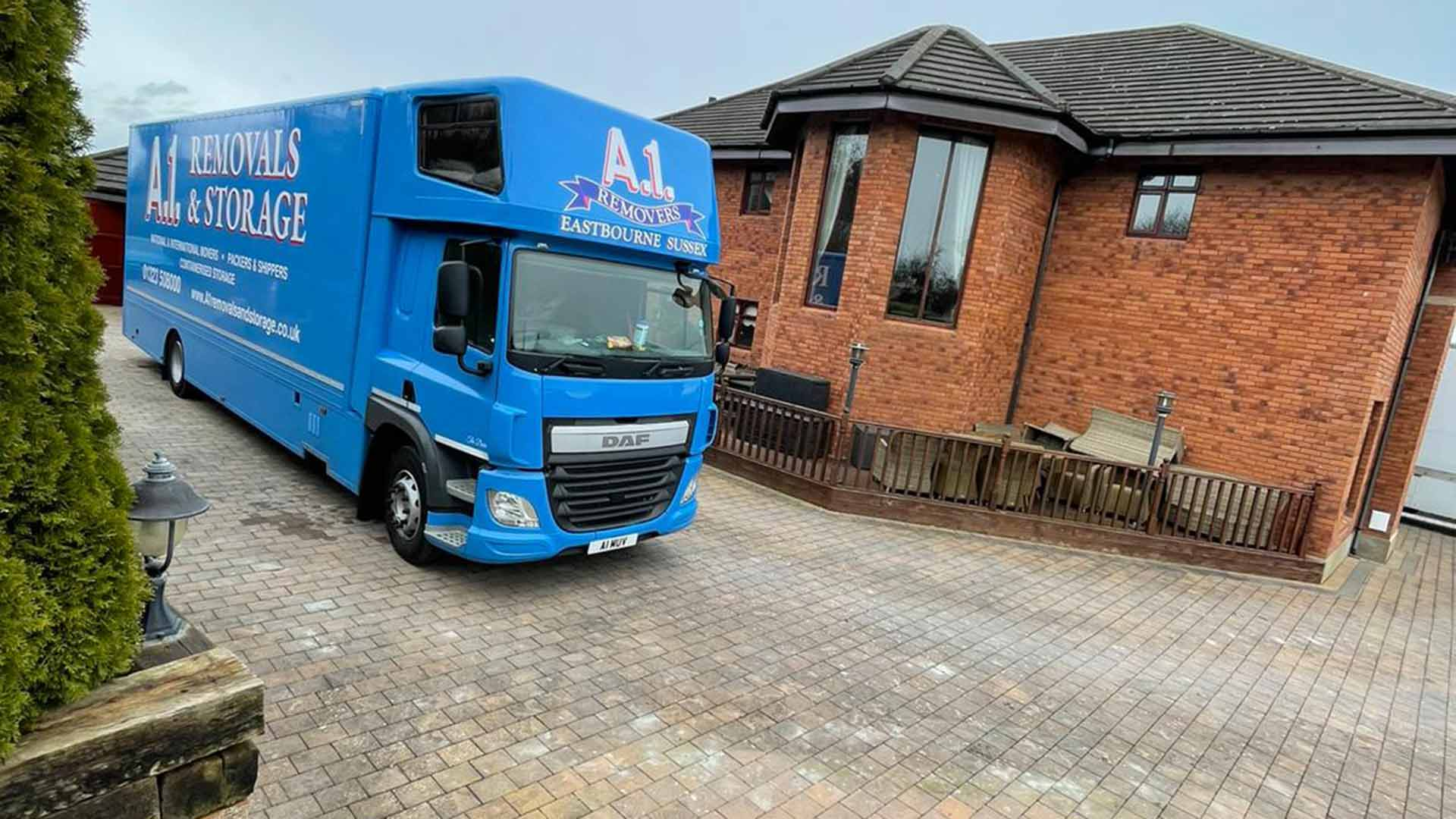 A1 Removals & Storage removals truck outside a large house