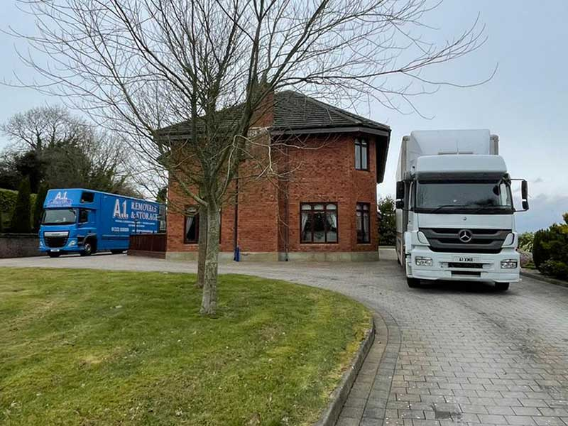A1 Removals & Storage truck parked next to a clients house