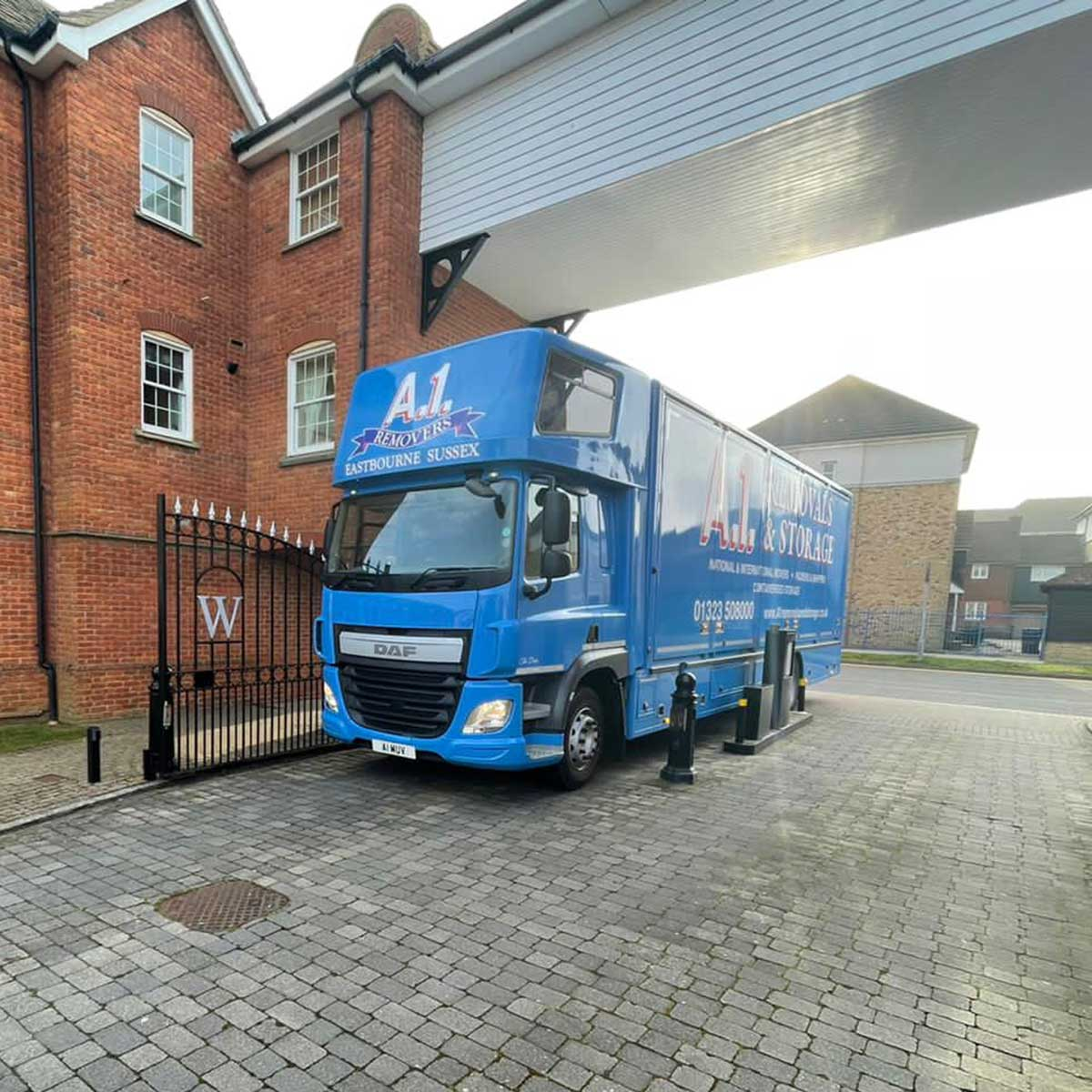 """A1 Removals van """"The Duke"""" arriving at a gated estate"""