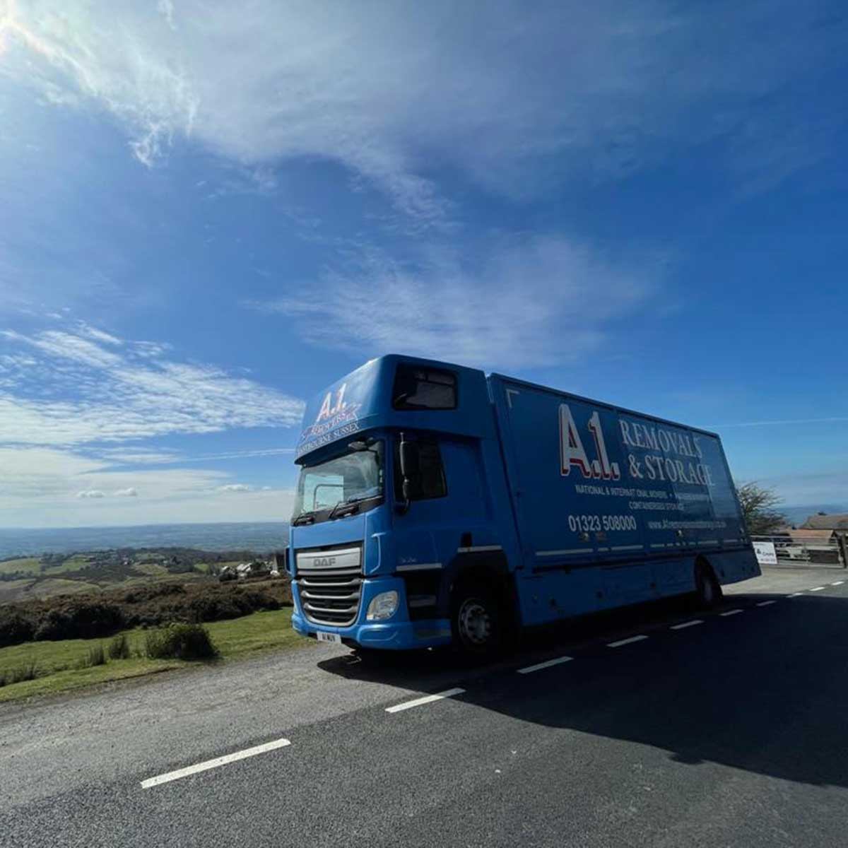 A1 Removals van in the sunshine on a coast road
