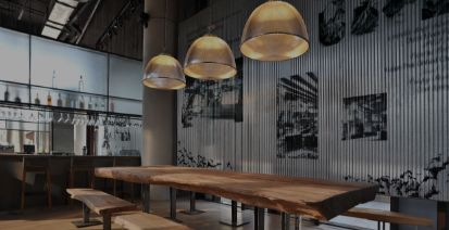 Restaurant space with wooden tables.