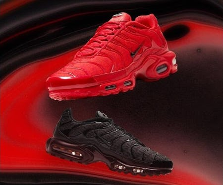 A red Nike DES and a black pair of Nike DES against a swirled red and black background