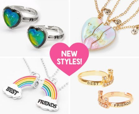 a heart that says BFF new styles and a photo grid that from top left to right and bottom left to right: 2 heart mood rings, a three person heart best friend necklace, a rainbow necklace that says best friends in the cloud section, and gold sequins and pearl gold rings that says best friends