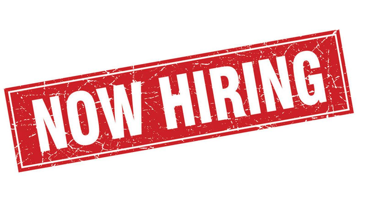 now hiring in white block letters on a red rectangle